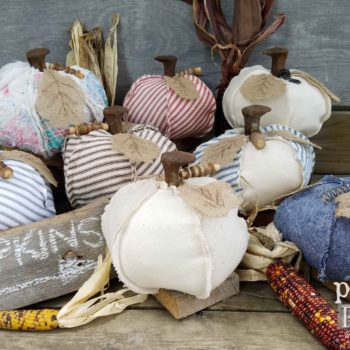 Add whimsy to your fall decor with these a repurposed pumpkin made by Prodigal Pieces. Feed sack, ticking, old quits are just some of the fun textures available. Get yours at prodigalpieces.com