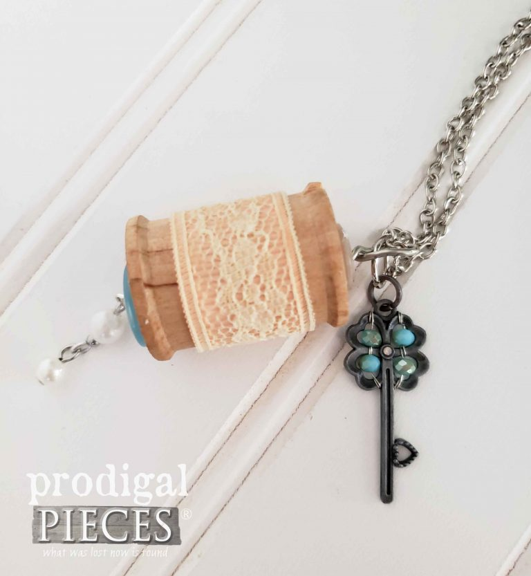 Blue Key Charm with Pink Lace on Vintage Wooden Spool Necklace available at shop.prodigalpieces.com
